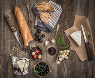 Cheese and other ingredients on a wooden table Stock Photos