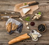 Cheese and other ingredients on a wooden table Royalty Free Stock Images
