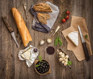 Cheese and other ingredients on a wooden table Stock Image