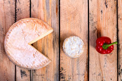 Cheese - pac-man. Two kind of cheese and a pepper - arranged in pac-man style Stock Photos