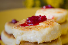 Cheese Pancake. With raspberry sauce royalty free stock photography