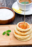 Cheese pancake with soured cream and dripping honey Stock Photos