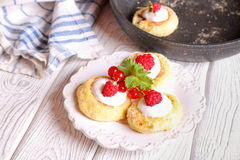 Cheese pancake, syrniki with raspberry and red currant. Close up, horizontal, top view Royalty Free Stock Photography
