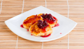 Cheese pancakes. With raspberry jam on white plate Royalty Free Stock Photos