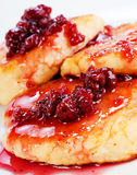 Cheese pancakes. With raspberry jam on white plate Royalty Free Stock Image