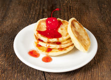 Cheese pancakes with cherry jam Stock Images
