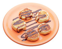 Cheese pancakes with chocolate syrup. On orange plate Royalty Free Stock Image