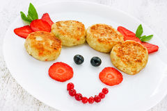 Cheese pancakes with fresh summer berries for child breakfast Royalty Free Stock Photography