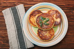 Cheese pancakes fried in a pan. Stock Image