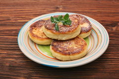 Cheese pancakes fried in a pan. Royalty Free Stock Photos