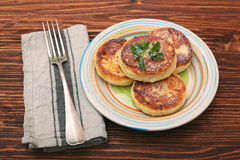 Cheese pancakes fried in a pan. Royalty Free Stock Photography