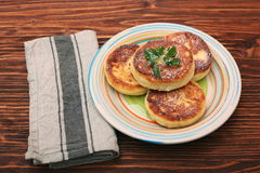 Cheese pancakes fried in a pan. Royalty Free Stock Photo