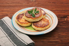 Cheese pancakes fried in a pan. Stock Photos