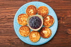Cheese pancakes fried in a pan. Royalty Free Stock Image