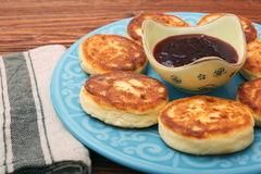 Cheese pancakes fried in a pan. Royalty Free Stock Images
