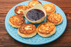 Cheese pancakes fried in a pan. Stock Images