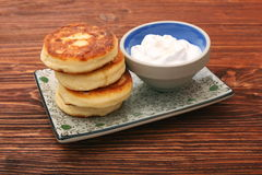 Cheese pancakes fried in a pan. Stock Photo