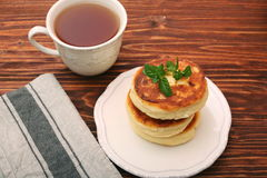 Cheese pancakes fried in a pan. Stock Photography