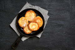 Cheese pancakes in frying pan Stock Photography