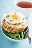 Cheese pancakes with green beans and egg Royalty Free Stock Images