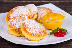 Cheese pancakes with honey Stock Image