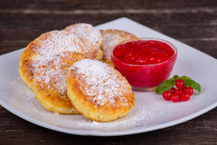 Cheese pancakes with honey in white plate. Stock Image