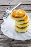 Cheese pancakes. On the plate in the form of shells on old desk Royalty Free Stock Photo