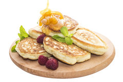 Cheese pancakes with raspberries and honey stock photos
