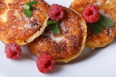 Cheese pancakes with raspberries and mint top view. Cheese pancakes with raspberries and mint on a white plate closeup. a horizontal top view Stock Photos