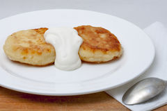 Cheese pancakes with sour cream Royalty Free Stock Image
