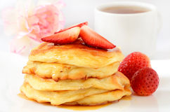 Cheese pancakes and strawberries Royalty Free Stock Image