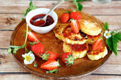 Cheese pancakes with strawberry jam Royalty Free Stock Photo