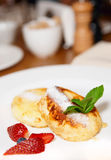 Cheese pancakes on white plate, close-up Stock Images