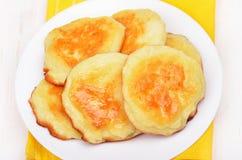 Cheese pancakes on white plate Royalty Free Stock Photos