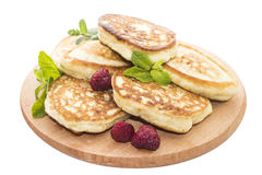Cheese pancakes on wooden board Stock Images