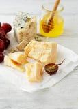 Cheese parmesan and honey Royalty Free Stock Photos