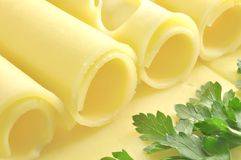 Cheese and parsley. Cheese rolled in tubes and parsley Royalty Free Stock Image