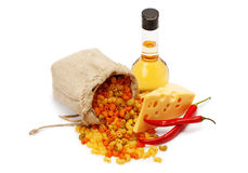 Cheese, pasta, olive oil and chili pepper Stock Photos