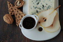 Cheese and pear Stock Images