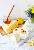 Cheese, pear and honey in a jar Royalty Free Stock Photo