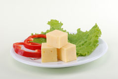 Cheese and pepper on a plate Stock Image