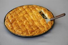 Cheese pie cut in pieces. Traditional greek Cheese in pan shot from above Stock Image
