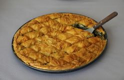 Cheese pie cut in pieces. Traditional greek Cheese in pan shot from above Stock Photos