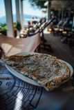 Cheese pie in Greek taverna stock photography