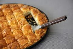 Traditional Cheese Pie. Cheese pie in pan cut in pieces Royalty Free Stock Photos