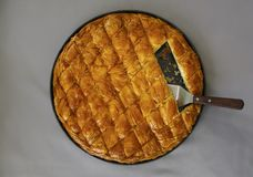 Cheese pie in pieces in pan. Traditional greek Cheese pie Filo Pastry Royalty Free Stock Image