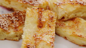 Cheese pie with sesame seed stock video footage