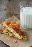 Cheese pie. Two slices of pie with cheese and dill and glass of milk Royalty Free Stock Photos