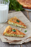 Cheese pie. Two slices of pie with cheese and dill and glass of milk Royalty Free Stock Photo