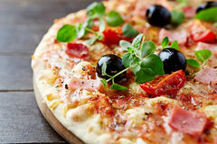 Cheese pizza with cherry tomatoes and ham Stock Photos